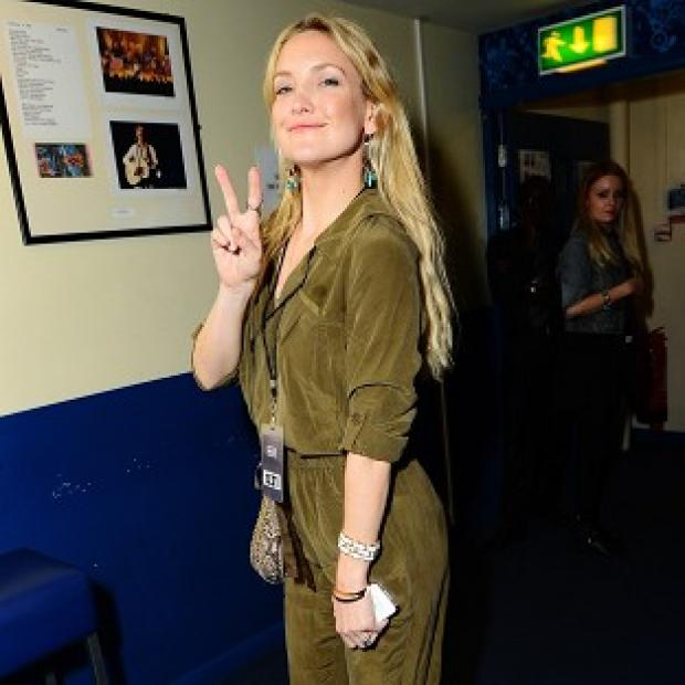 Kate Hudson plays groupie at husband Matt Bellamy's War Child BRIT Awards Concert with Muse