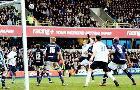 Josh King sees his header come back off the post at the Den