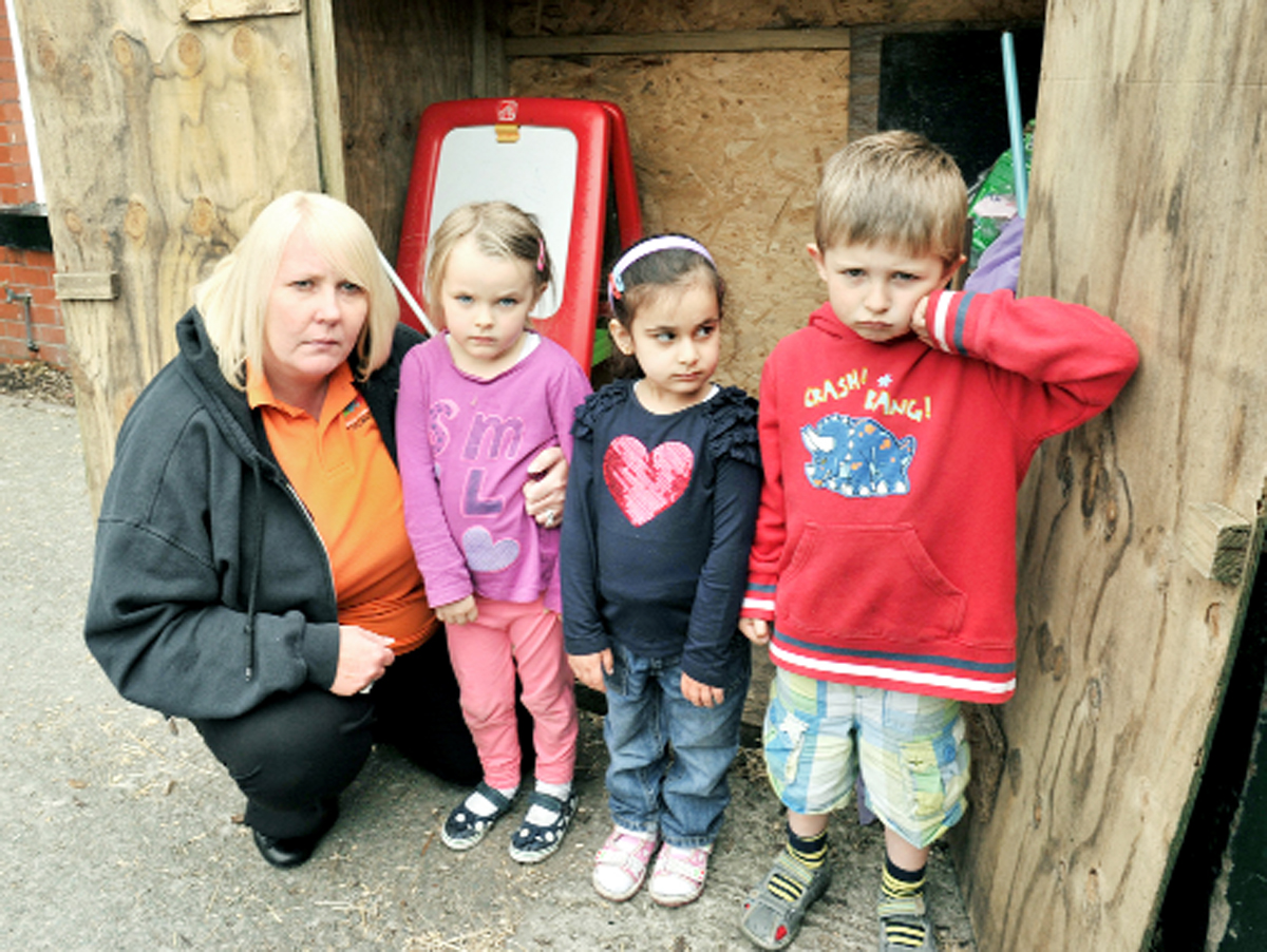 Hayley Lovell with Amy O'Callaghan, Nafia Rehan and George Rolston at the shed from where the toys were taken