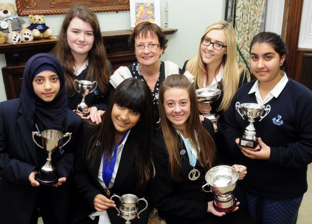 This Is Lancashire: BRIGHT SPARKS Pictured are, front, Yasmin Khaliq 17, deputy head girl, and Caroline McKittrick, 17, head girl (right). At the back, from left, are Saba Khalil, 11, Charlotte Carter, 13, Bobby Georghiou, headteacher, Olivia Speakman, 16, and Hadis Rayhani,