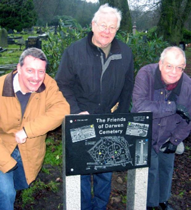 This Is Lancashire: Brent Stevenson, John Jacklin and John East with one of the new granite cemetery maps
