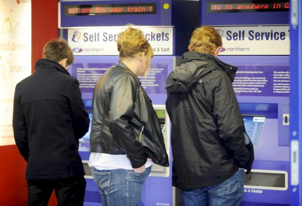This Is Lancashire: Passengers try to buy tickets at Bolton's Trinity Street rail station