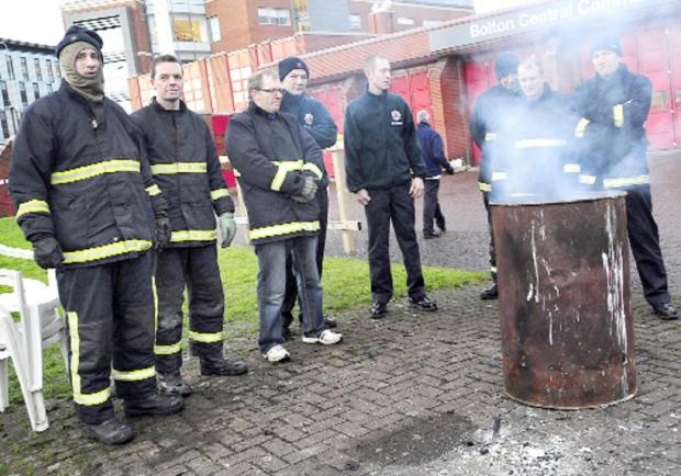 This Is Lancashire: Firefighters strike over pensions outside Bolton Central Fire Station