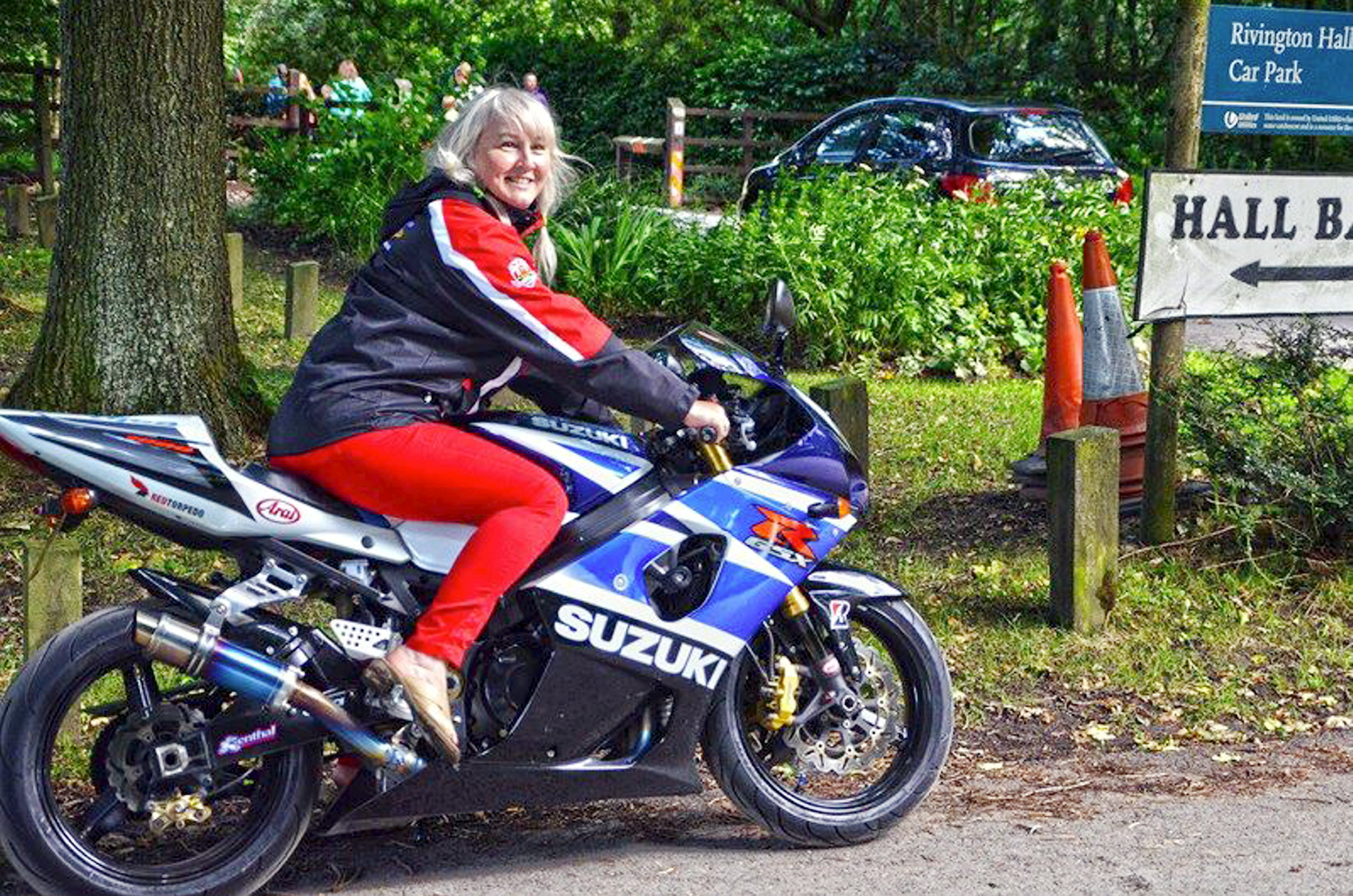 Susan Rigby rides into Rivington Barn on a Suzuki GSXR