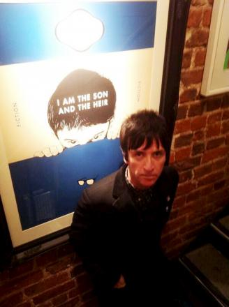 Johnny Marr in front of the iconic print at the Ramsbottom gallery