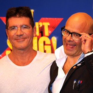 Simon Cowell is said to be missing the launch of the X Factor musical, written by Harry Hill