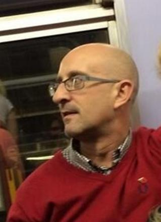 A man wanted in connection with an incident in which train passengers were spat on
