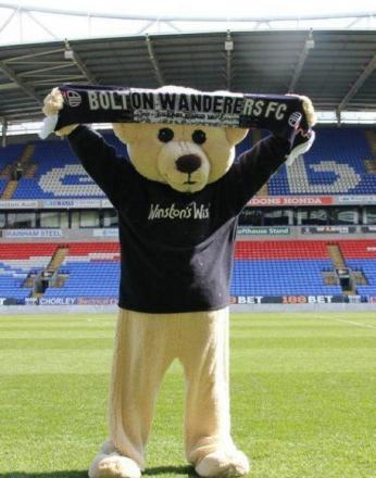 Winston Bear, at the Reebok, celebrates his charity being supported by Bolton Wanderers