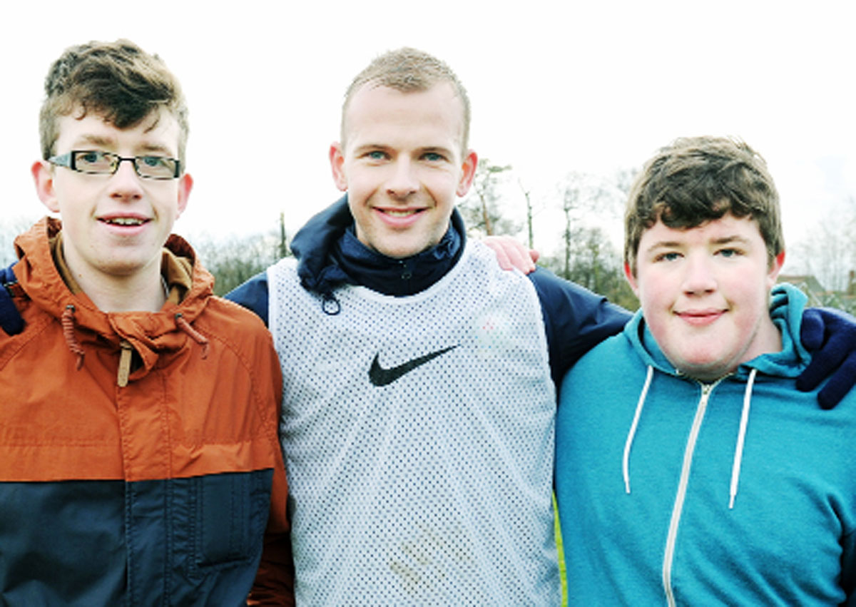 Ben and his younger brother Liam with their favourite player Jordan Rhodes.