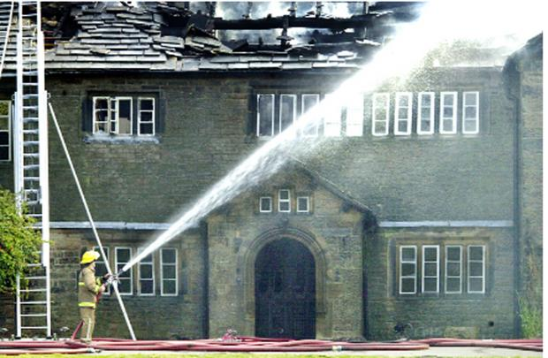 Holme Hall following an arson attack in 2004