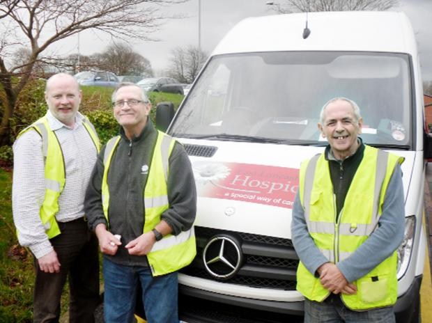 With the hospice van, from left, Steven Youds (warehouse manager) and volunteer drivers Tony Burke and Paul Wallwork