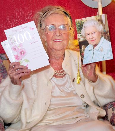 Mary Hutchinson with her birthday cards, including the one from the Queen