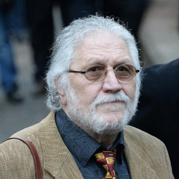 This Is Lancashire: DJ Dave Lee Travis is accused of a series of assaults