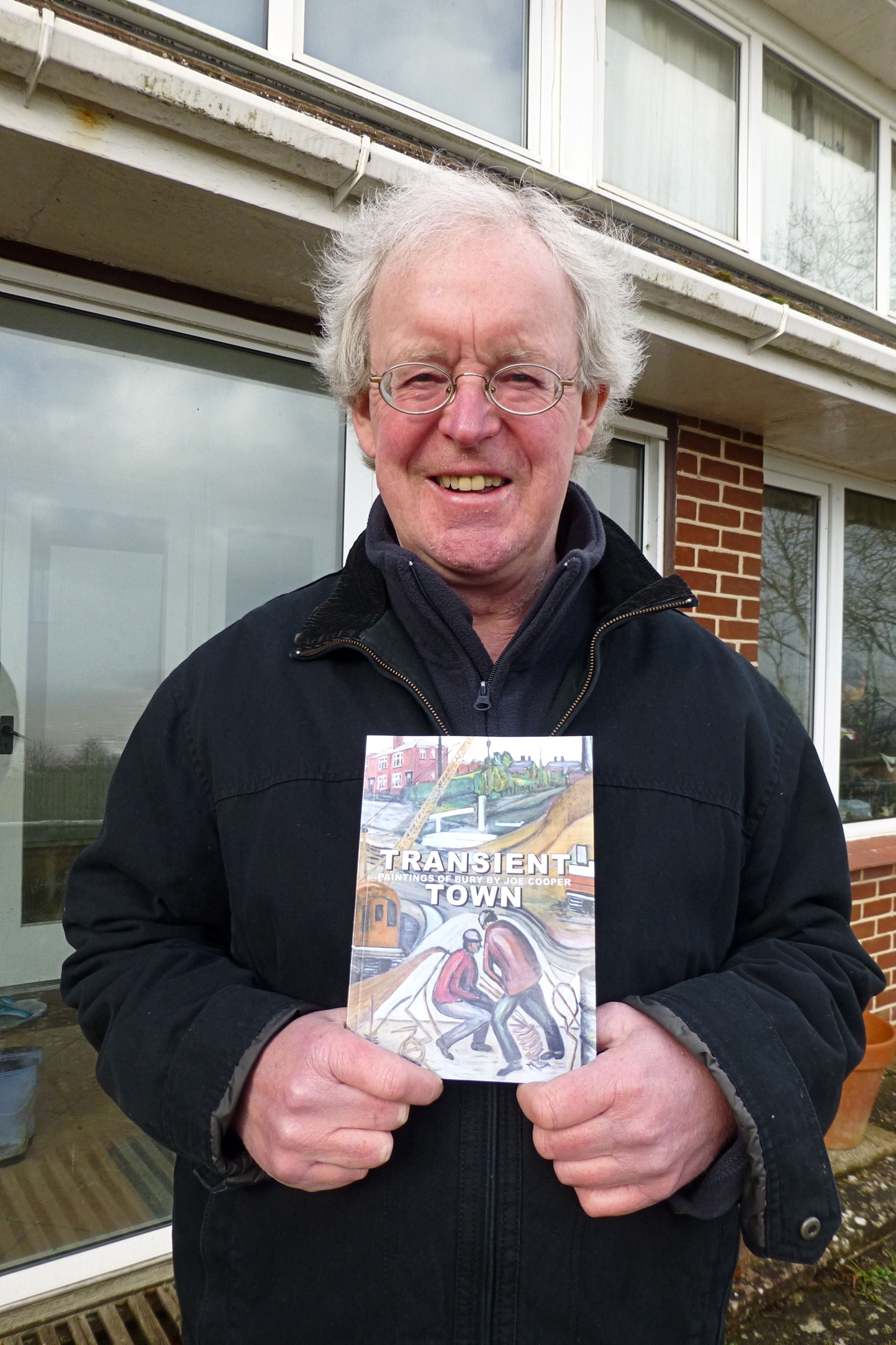 Graham Cooper with his new publication Transient Town