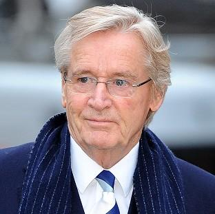 This Is Lancashire: Coronation street actor Bill Roache arrives at Preston Crown Court where he faces two counts of raping a 15-year-old girl in east Lancashire in 1967, and five indecent assaults involving four girls aged between 11 or 12 and 16 in the Manchester area in 19