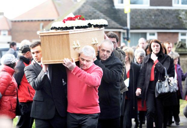 This Is Lancashire: Mourners wore red to mark Paul having been a Manchester United fan