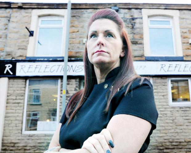 This Is Lancashire: Gail Simpson from Reflections hairdressers on Gannow Lane, Burnley, which was broken into