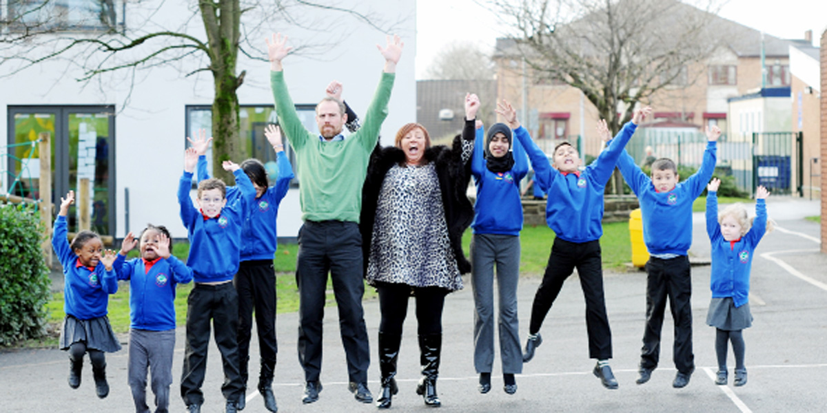 Headteacher Carla Martini and deputy Christopher Holmes are jumping for joy at St Barnabas and St Paul's results