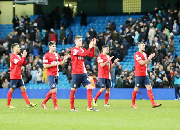 Blackburn Rovers players show their appreciation to the travelling fans at Manchester City on Wednesday