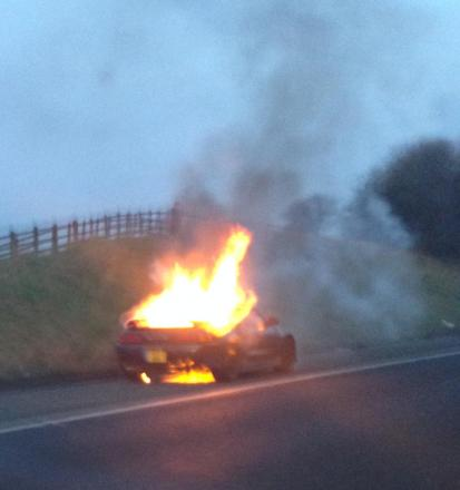 The car on fire on the M66