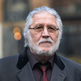 This Is Lancashire: DJ Dave Lee Travis arrives at Southwark Crown Court in London