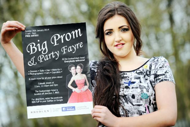 Shelby with a poster advertising the Big Prom and Party Fayre