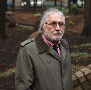 Former DJ Dave Lee Travis arriving at Southwark Crown Court in London