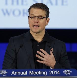 Matt Damon accepting the Crystal award at the World Economic Forum