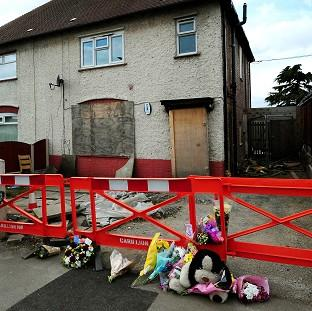 This Is Lancashire: Mick Philpott's house, where the six children died in the fire on May 11 2012