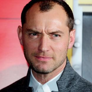 This Is Lancashire: Actor Jude Law is to give evidence in the phone-hacking trial of Rebekah Brooks at the Old Bailey