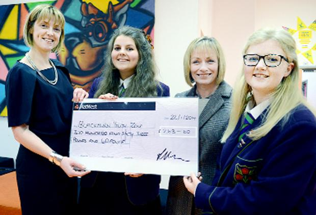 This Is Lancashire: From left, the Youth Zone's Julie Wright, head girl Harriet Dagnall, principal Lynne Horne and deputy head girl Lucy Horsfield with the school's donation