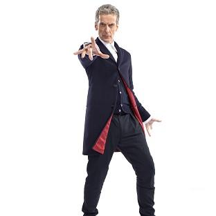 New Doctorr Who star Peter Capaldi showing his costume, a dark blue Crombie coat with red lining, dark blue trousers, a white shirt as well as black Dr Martens shoes