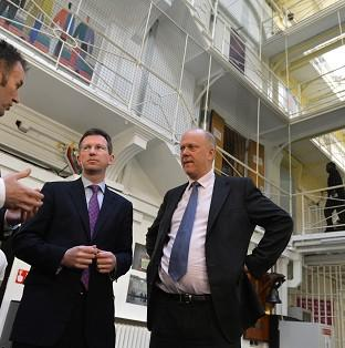 This Is Lancashire: Jeremy Wright (centre) says employment can make a vital difference to the likelihood of reoffending.