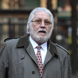 This Is Lancashire: DJ Dave Lee Travis is accused of a series of indecent assaults and one sexual assault