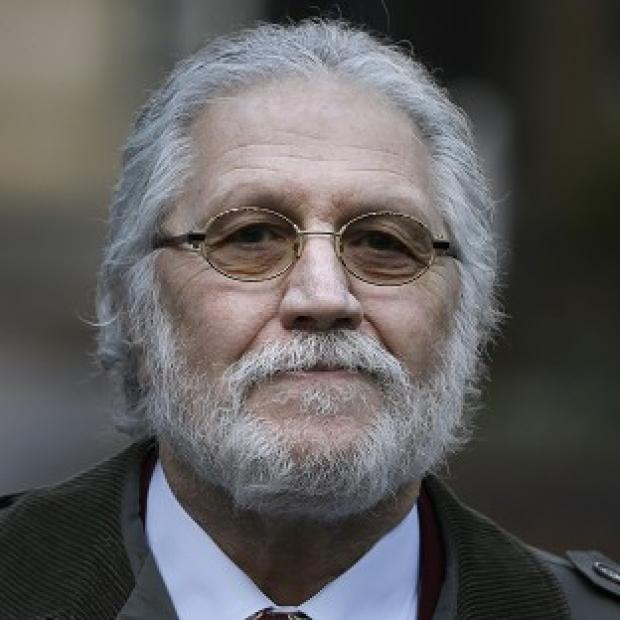 This Is Lancashire: Dave Lee Travis denies a string of indecent assaults and one sexual assault