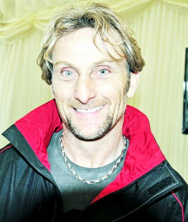 Carl Fogarty swaps two wheels for four at Blackburn College opening