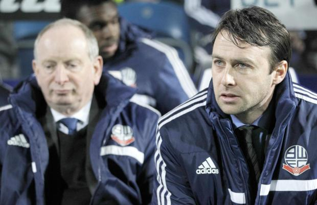This Is Lancashire: FAITH Dougie Freedman, right, and his assistant Lenny Lawrence watching on from the sidelines at QPR