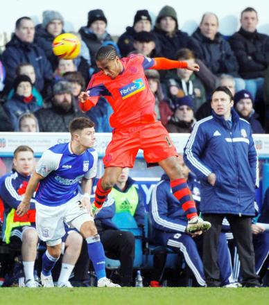 KEEPING FOCUS Wanderers boss Dougie Freedman watches on as Neil Danns goes up for a header in the defeat at Ipswich