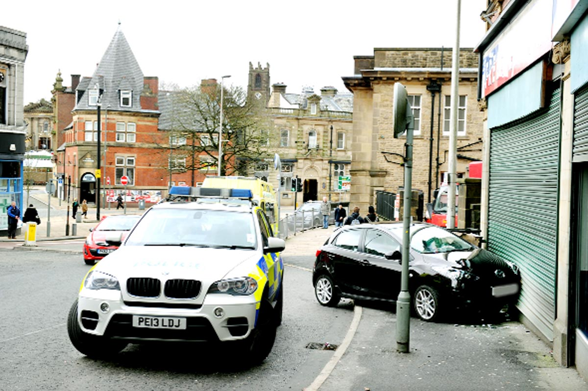 Man hurt as car hits takeaway in Darwen