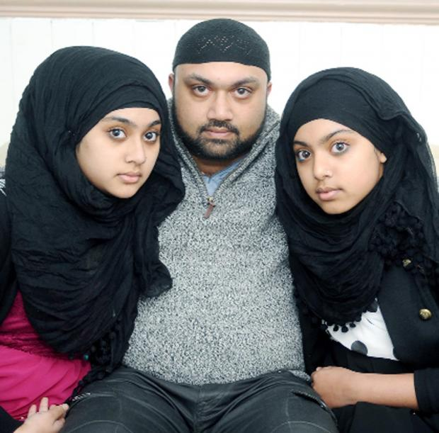 This Is Lancashire: Ibby Ali with his daughters   Anisha, left, and Ayesha
