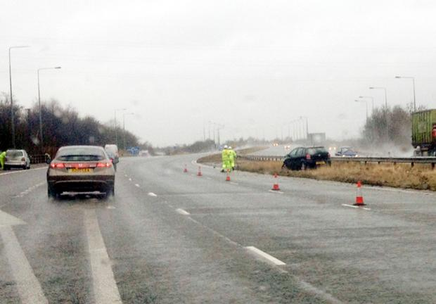 This Is Lancashire: Emergency services attend car crash on M65 near Burnley