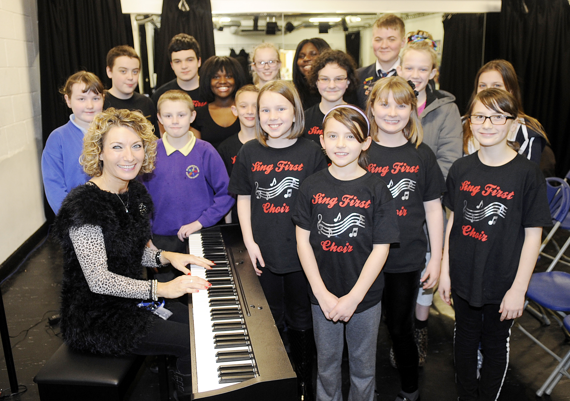 Musical director of Sing First Bury Katie Geelan with the choir at rehearsals
