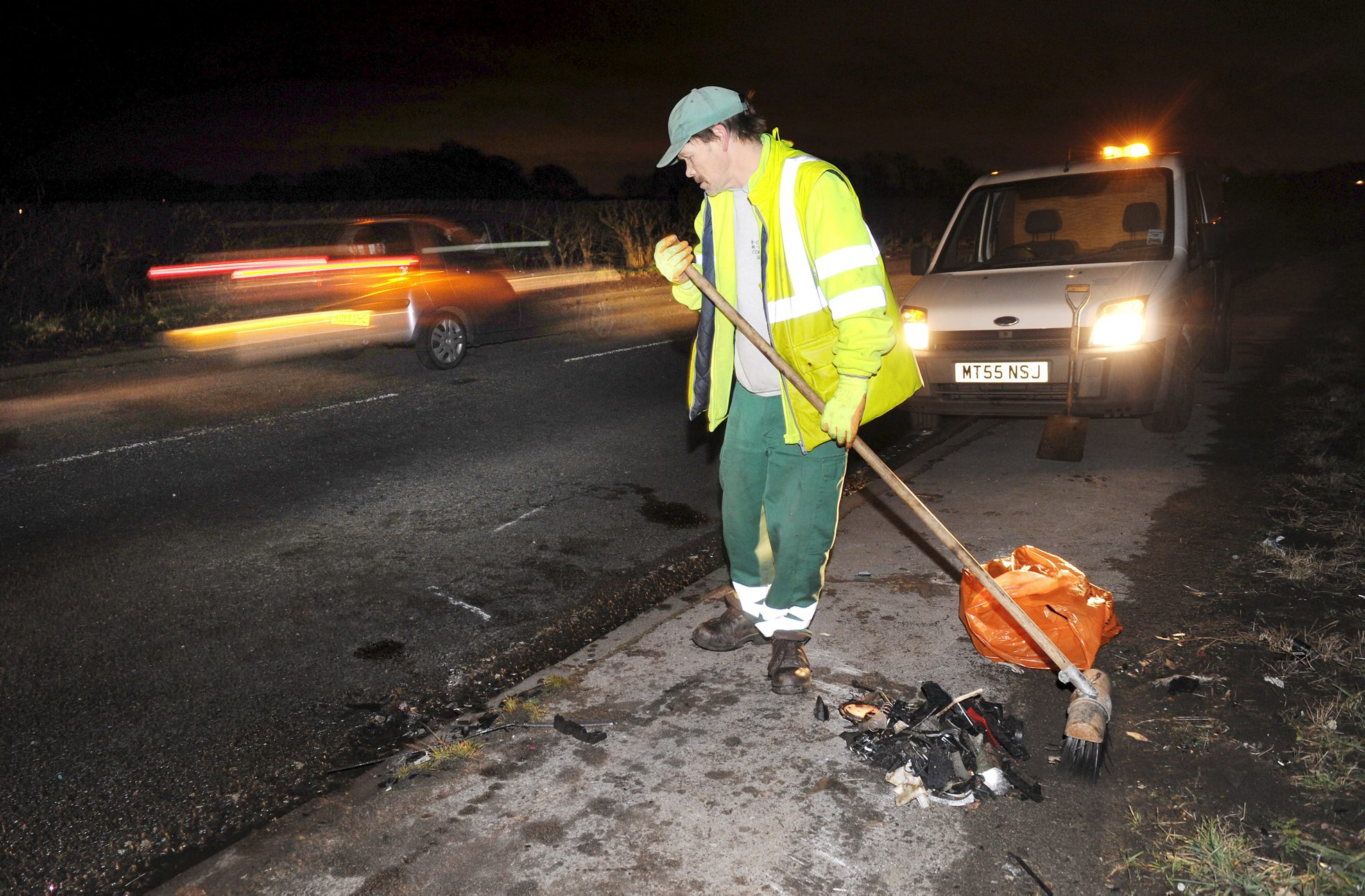 A worker cleans up after the crash on the A6 in Blackrod