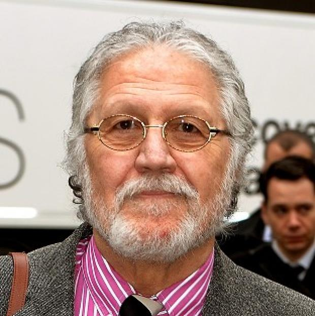 This Is Lancashire: DJ Dave Lee Travis arrives at Southwark Crown Court in London, where he is accused of 13 counts of indecent assault and one count of sexual assault in 2008
