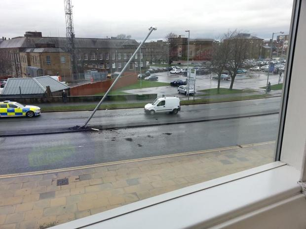 Lamppost left dangling after car accident in Burnley