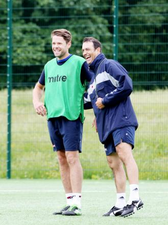 Assistant manager Paul Stephenson (right) with James Beattie