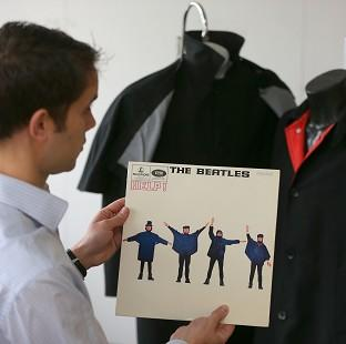 This Is Lancashire: Auctioneer Paul Fairweather with jackets worn by George Harrison (right) and Ringo Starr on the cover of the Beatles album Help!