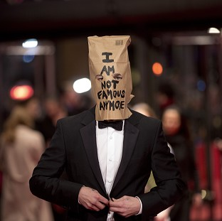 Shia LaBeouf posed for photos with a paper bag over his head