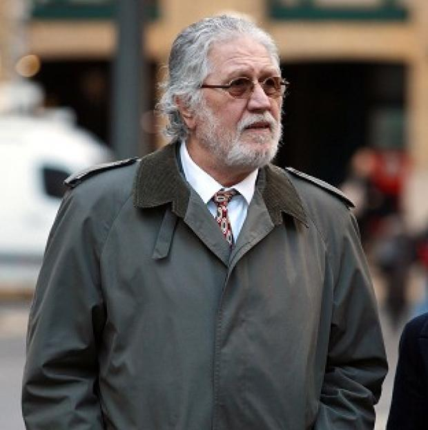 This Is Lancashire: DJ Dave Lee Travis is accused of 13 counts of indecent assault and one count of sexual assault