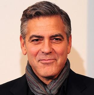 This Is Lancashire: George Clooney attends a photocall for his new film The Monuments Men at the National Gallery in central London